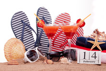 Beach Accessories, Calendar With Date 14 February And Two Glasses With Cocktail. Beach Holidays. Valentine's Day,