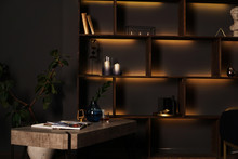 Black Room Interior. Shelves With Orange Light.