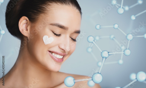 Fotomural  Woman With Cream In Hearth Shape On Her Cheek
