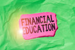 canvas print picture - Word writing text Financial Education. Business photo showcasing education and understanding of various financial areas Green crumpled ripped colored paper sheet centre torn colorful background