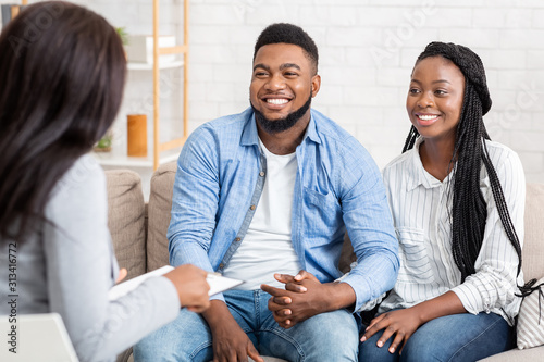 Portrait Of Happy African American Couple After Successful Marital Therapy Session
