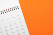 canvas print picture - close up of calendar on the orange table, planning for business meeting or travel planning concept