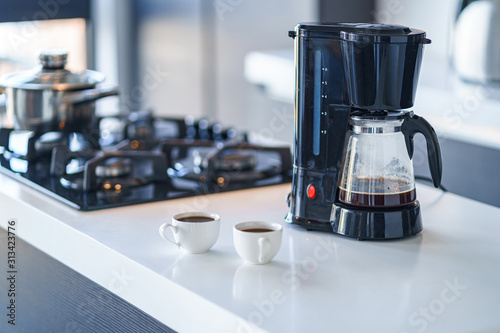 Obraz Coffee maker for making and brewing coffee at home. Coffee blender and household kitchen appliances for makes hot drinks - fototapety do salonu