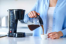 Woman Using Coffee Maker For M...