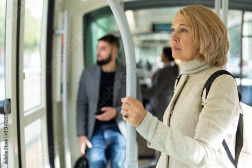 Thoughtful mature woman in streetcar