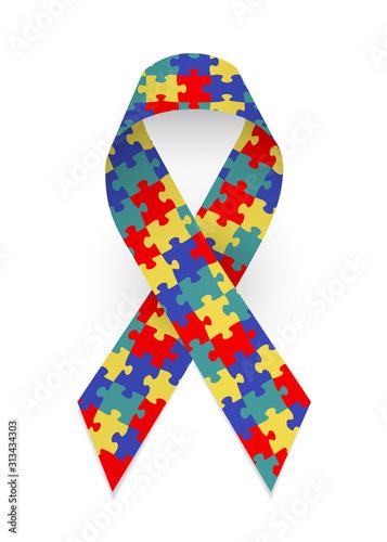 Photo Colorful satin puzzle ribbon as symbol autism awareness