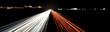 canvas print picture - autobahnlichtspuren stadtsilhouette in der nacht