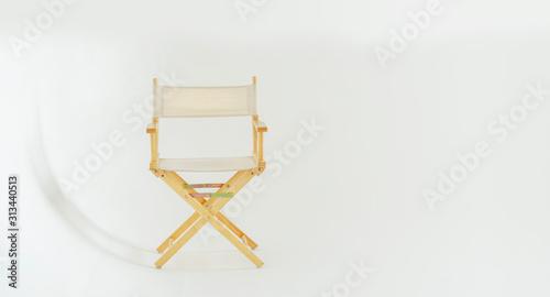 Fototapeta The director's chair in the white studio