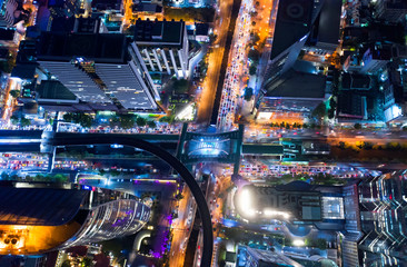 Top view city , Aerial view road , Expressway with car lots in the city in Thailand. Beautiful Street at downtown.Road roundabout.