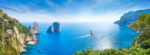 Panoramic collage with famous Faraglioni Rocks, Marina Piccola and Monte Solaro on Capri Island, Italy.
