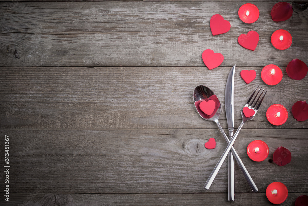 Fototapeta Celebration food concept. Fork, spoon and knife on wooden table.