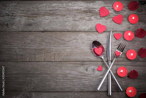 Obraz Celebration food concept. Fork, spoon and knife on wooden table.  - fototapety do salonu