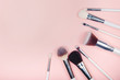 Set makeup brushes on pink color background. Top view point, flat lay
