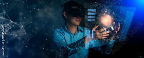 young asian technician man working and hand touch effect of magic from Virtual r Wallpaper Mural