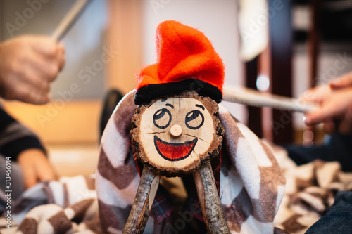 Fotografia caga tió, Catalan Christmas tradition tree trunk that is beaten with sticks, wit