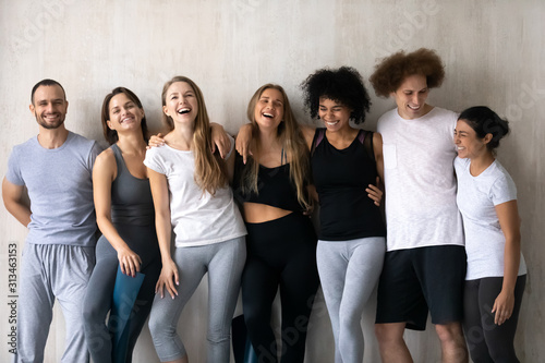 Obraz Happy diverse people having fun after group yoga lesson - fototapety do salonu