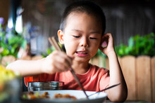 Asian Boy Having Lunch At The ...
