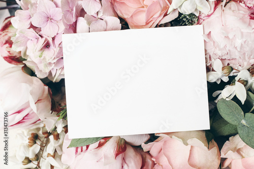 Wedding, birthday stationery mock-up scene. Blank paper greeting card, invitation. Decorative floral composition. Closeup of pink roses petals, peonies, hydrangea flowers and eucalyptus leaves. - 313473766