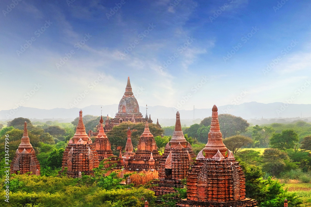Fototapeta Blue sky above temples surrounded by green vegetation in old Bagan, Myanmar.