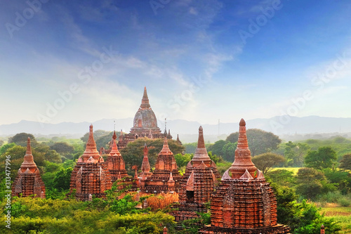 Blue sky above temples surrounded by green vegetation in old Bagan, Myanmar Canvas Print
