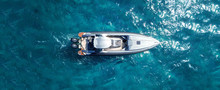 Aerial Drone Ultra Wide Photo Of Inflatable Rib Docked In Tropical Exotic Bay
