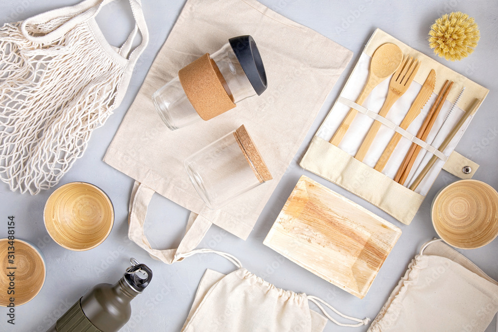 Fototapeta Zero waste kit. Set of eco friendly bamboo cutlery, mesh cotton bag, reusable coffee tumbler and water bottle. Sustainable, ethical, plastic free lifestyle.