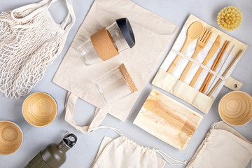 Zero waste kit. Set of eco friendly bamboo cutlery, mesh cotton bag, reusable coffee tumbler and water bottle. Sustainable, ethical, plastic free lifestyle.