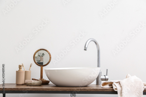 Body care cosmetics with accessories near sink in bathroom Wallpaper Mural