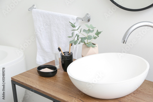 Fotomural Body care cosmetics with toothbrushes near sink in bathroom