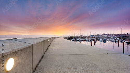 Fotografie, Obraz Amazing sky on sunrise at Greystones yacht marina or harbour with anchored boats and long illuminated pier