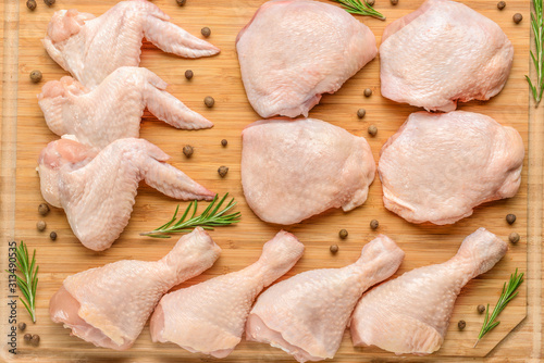 Obraz Raw chicken meat on wooden background - fototapety do salonu