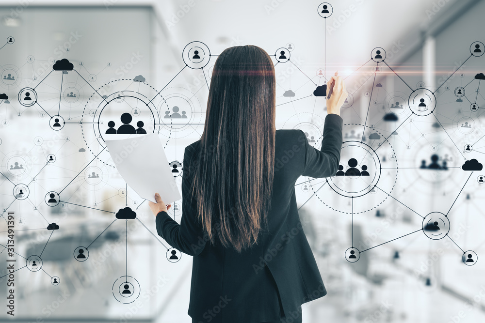 Fototapeta Young woman drawing social network interface