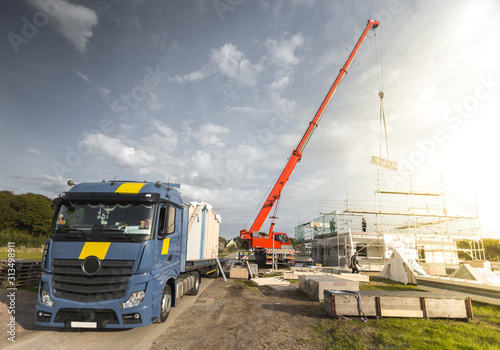 Construction of a Single Family Home with the Help of a Crane Canvas Print