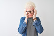 canvas print picture - Young albino blond man wearing denim shirt and glasses over isolated white background with hand on headache because stress. Suffering migraine.