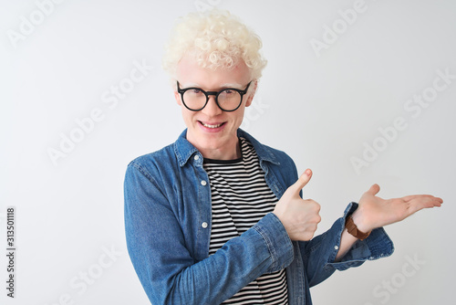 Young albino blond man wearing denim shirt and glasses over isolated white backg Wallpaper Mural