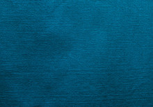 Blue Fabric Texture. Background Of Blue Fabric With Seam And Holes.