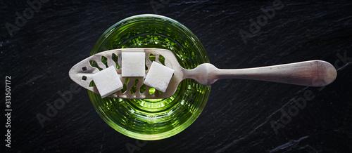 Obraz na plátně absinthe with sugar cubes and spoon flat lay composition