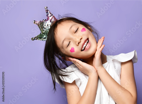 Fotografie, Tablou Asian Korean kid girl princess in crown closeup portrait Happy smiling laughing