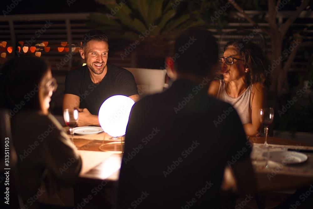 Fototapeta Beautiful family on dinner talking and smiling at terrace