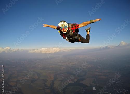 Parachutist dressed as a clown on Halloween. #313513339