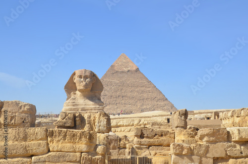 Fototapety, obrazy: Great pyramid of Cheops and Sphinx in Giza plateau. The Great Pyramid of Giza at the back.