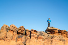Male Hiker On A Sandstone Cliff