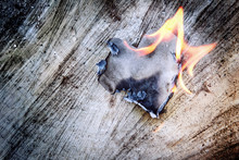 Paper Heart On Fire On A Woode...