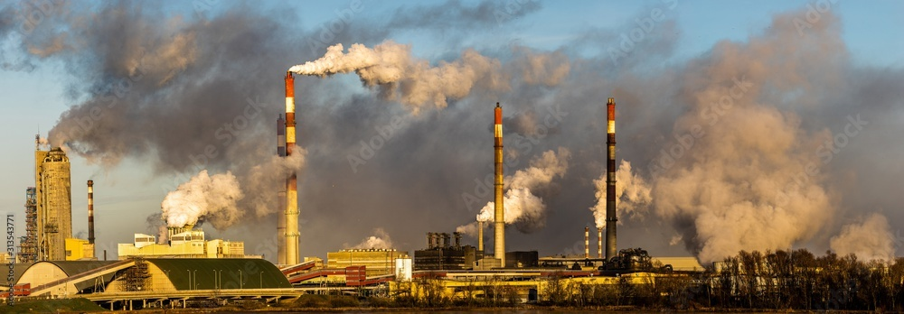 Fototapeta chemical plant in Poland emitting huge amounts of smoke, dust and pollutants emitted into the atmosphere