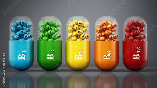 Fototapeta Various vitamin B pills standing on dark gray background. 3D illustration obraz