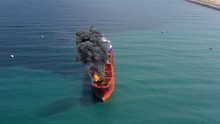 Aerial Footage Over Oil Tanker Ship Burning Under Attack Aerial View With Visual Effect Elements Simulates Realistic Vision Of Oil Tanker On Fire With Smoke In Gulf Sea.