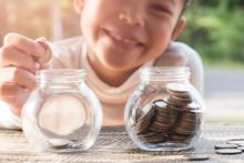 Asian Kid Saving Money Putting...