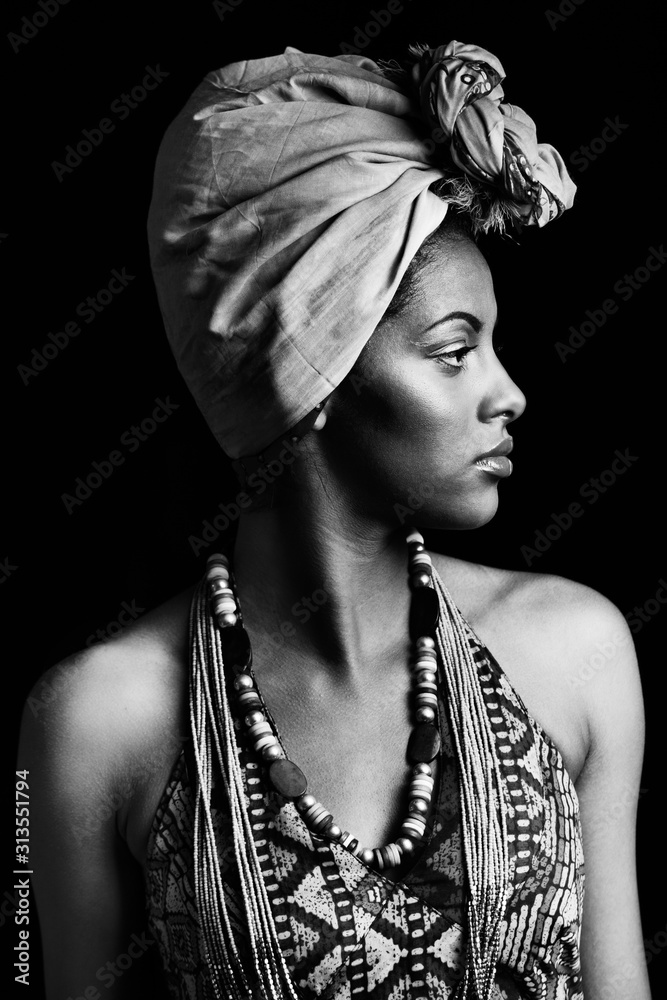 Fototapeta african black young woman portrait with turban headscarf studio shot black and white