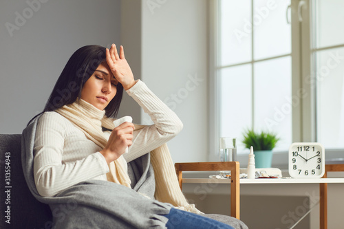 Obraz Sick girl with flu common cold flu symptoms in room at home - fototapety do salonu