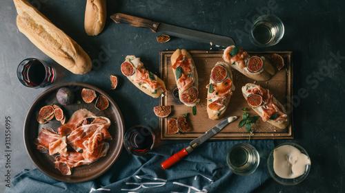 Spanish snacks and wine on a dark concrete background Canvas Print